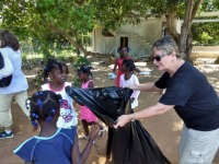 Sharon teaching kids about cleaning up area