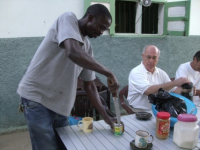 67 Joeseph opening milk with a machettee