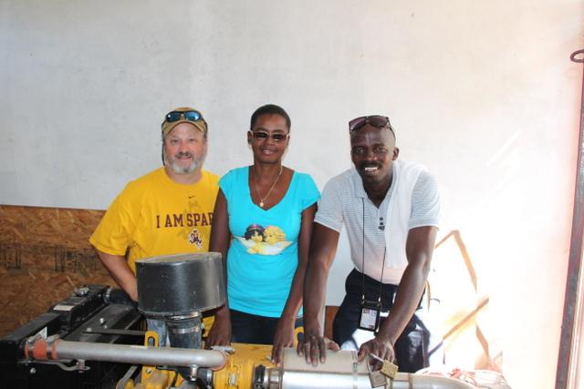 Dr. Dan, Gentila and Joseph with generator