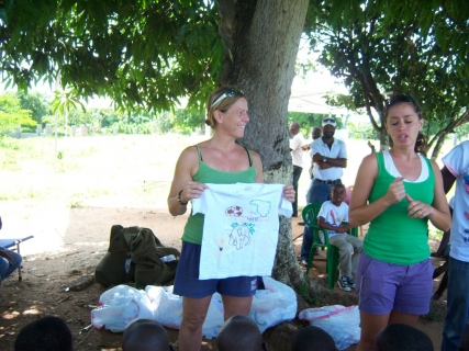 Handing out T-shirts to the boys