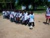 Little boys doing soccer drills at camp