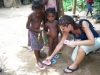 Handing out shoes in the local villages