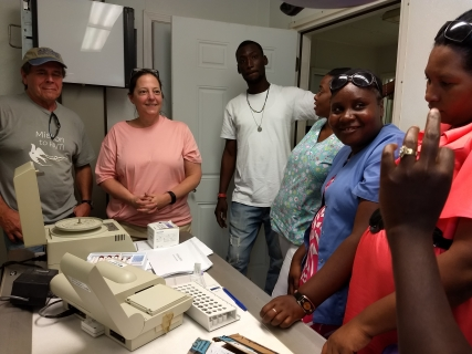 Allyn teaching medical staff on new blood machine