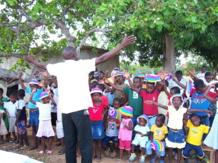 Worshiping at church under a mango tree