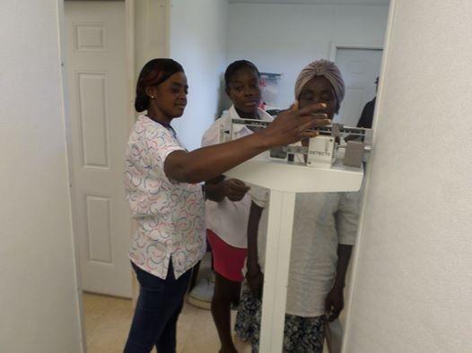 Gentilia (Haitain nurse) helping out