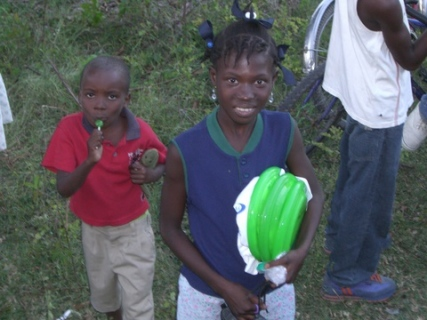 230 child with gifts on land