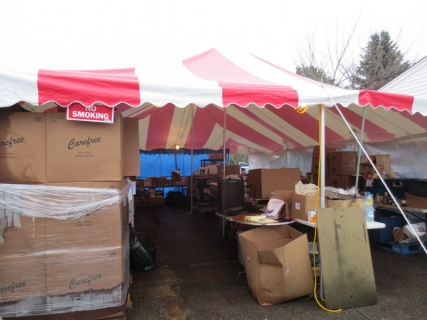 Pallets of relief supplies come in weekly