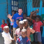 Patrick and children in front of Aslan Mission House in Ounanminthe